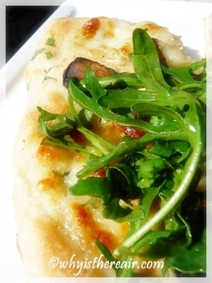 Thermomix pizza dough makes excellent white pizza with a rocket salad on top