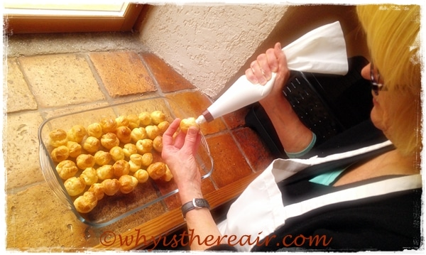 Here's Madame Thermomix piping firmly set thyme-infused goats' cheese mousse into her mini choux pastry