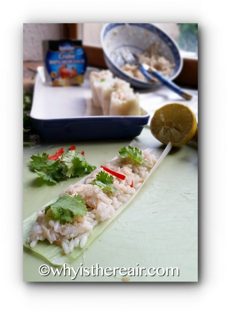 Spread leek sheets with crab and rice mixture, dot with coriander and chilli, then roll from one end