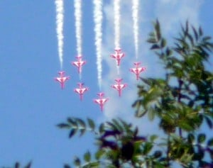 Red Arrows in formation Farnborough 2010